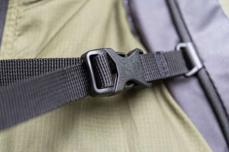 Backpack chest buckle. Touring backpack strap with buckle. Black fastex.