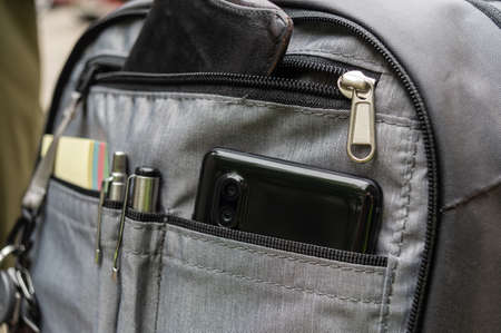 Backpack section with organizer.. Smartphone, keys, wallet in a backpack. Urban backpack with organizer. Фото со стока