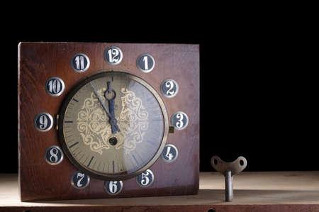 Old table clock. Old clock in a wooden case. Clockwork Soviet clock.