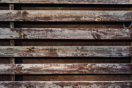 Background from old boards. Horizontal wooden stripes. Old shabby wood planks. Wood strips.