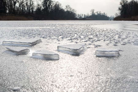 Chunks of frozen ice. Ice chunks on ice. Severe frost outside. The frozen river. Daylight.
