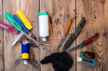 A variety of tools and knives. Several sharpened knives. Sharpening and cleaning knives.