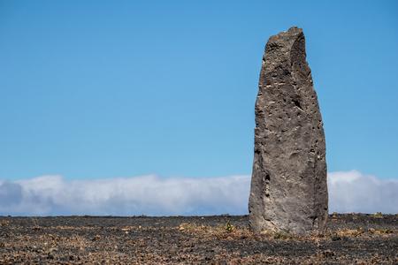 Stone column against a blue cloudy sky