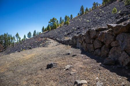 Mountainous rocky trail passing through frozen volcanic lava