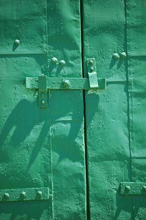 green metal window shutter Imagens