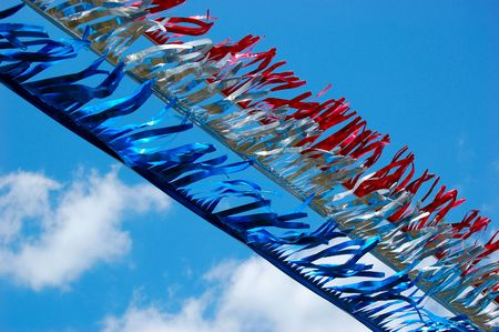 red white and blue streamers in the wind Imagens
