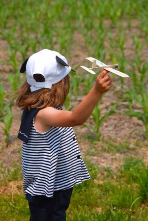 young girl with toy airplane