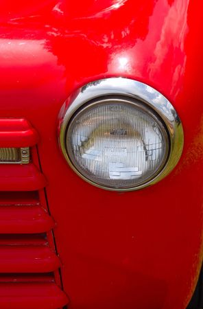 headlight and fender detail of classic auto