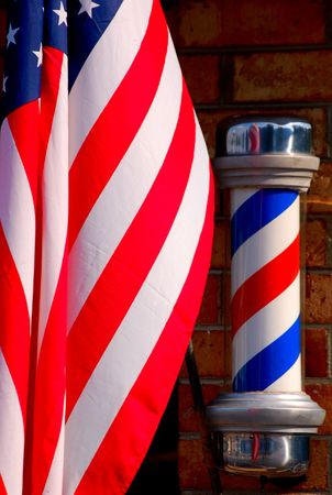 barber shop: barber pole and flag Stock Photo