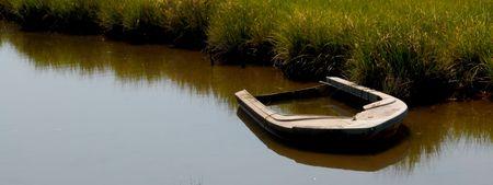 swampland: abandon wood boat  Stock Photo