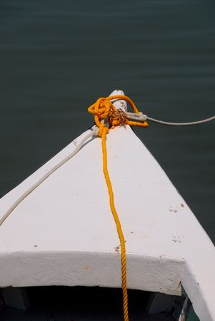 wood boat with yellow line