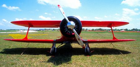 front view of red biplane
