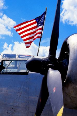 propeller aircraft with flag photo