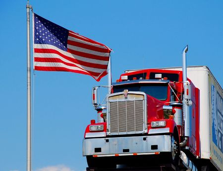 hauling tractor: tractor-trailer with American flag