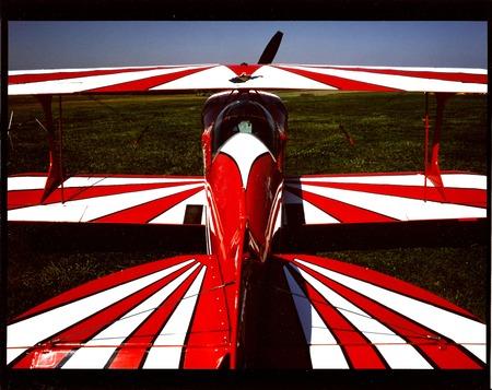 colorful biplane on ground