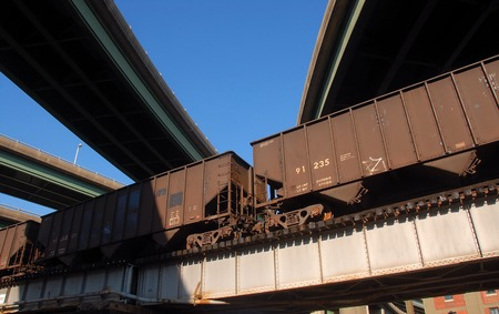 overpass: railcars and highway overpass Stock Photo