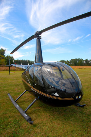 light helicopter parked on the grass