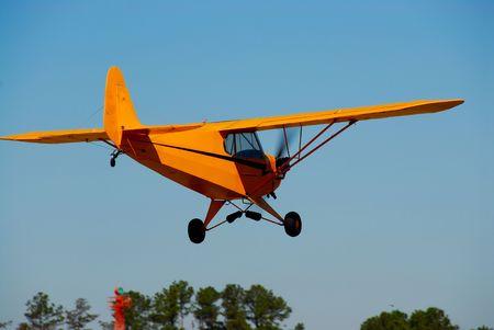 classic small airplane in flight Banco de Imagens