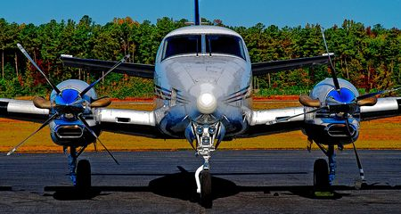 posterized image of executive turboprop airplane