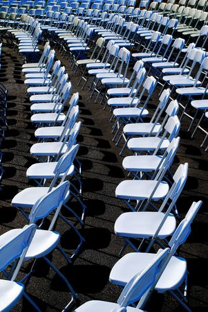 white  chairs awaiting audience