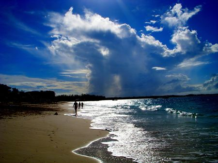 Caribbean beach with storm clouds on the horizon