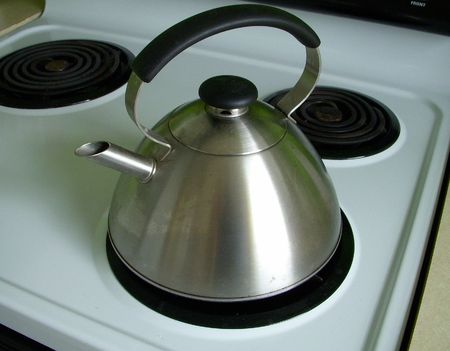 stove: kettle on electric stove Stock Photo