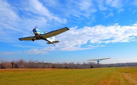 tow plane and glider taking off from a grass runway