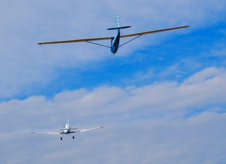 towplane and glider in flight