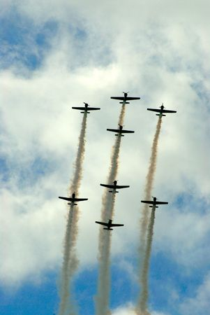 classic aircraft in formation at airshow