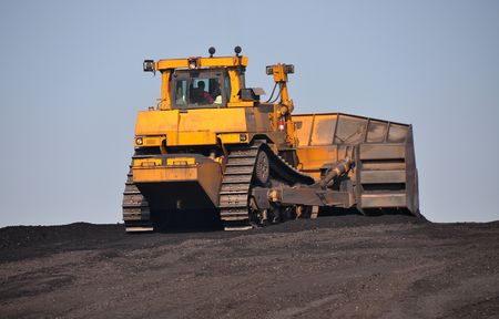 bulldoze: bulldozer moving coal