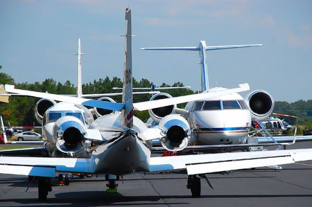 airport crowded with corporate jets