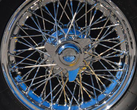 spoke: wire spoke automobile wheel Stock Photo
