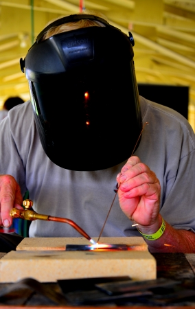 man welding in mask