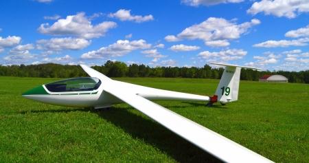sailplane on grass runway