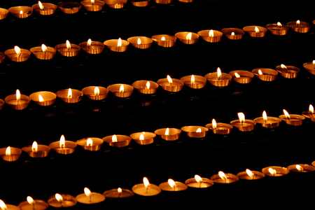 votive candle: rows of votive candles Stock Photo