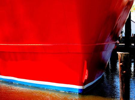 red fishing boat hull Imagens