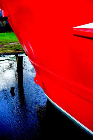 hull: red fishing boat hull Stock Photo