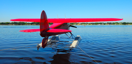 red aircraft on floats