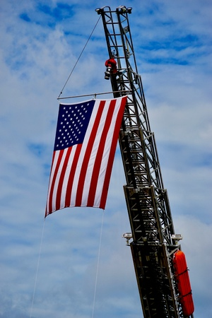 Flag on fire truck ladder