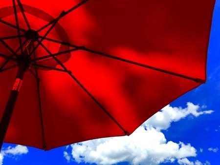 Red umbrella and blue sky Reklamní fotografie