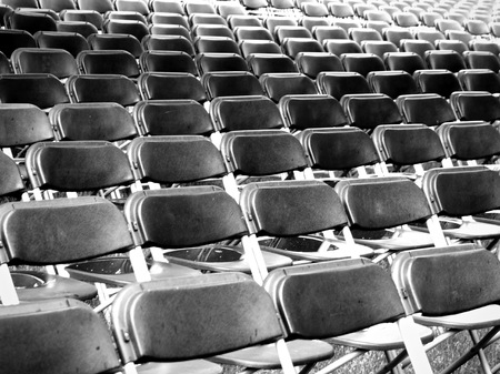 empty chairs at outdoor gathering