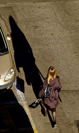 shadow of woman on a city street