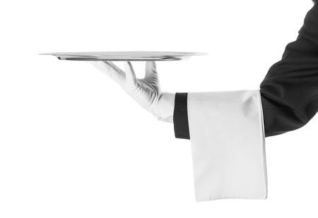 A hand holding a silver tray Stock Photo