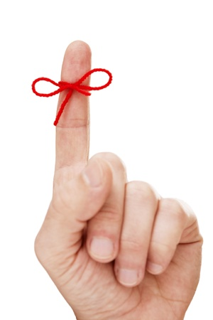 Finger with tied bow Stock Photo