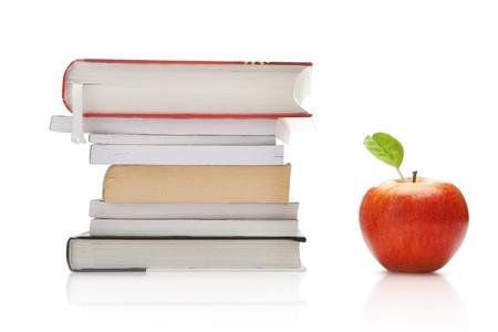 book binding: Books and apple