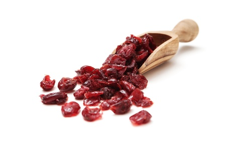 Dried cranberry in a wooden scoop