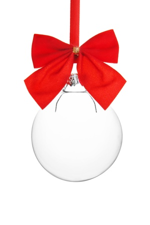 Transparent empty Christmas ball hanging on red ribbon