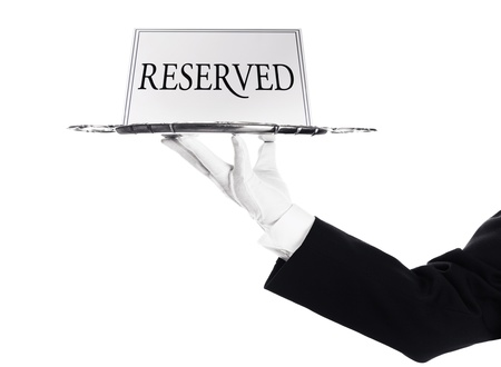reserved sign: Reserved -A hand holding a silver tray with reserved sign