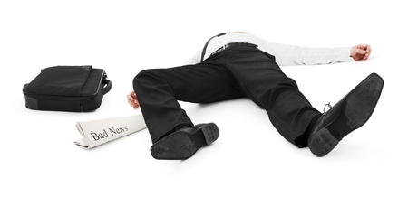 lay down: Businessman unconscious because of bad news Stock Photo
