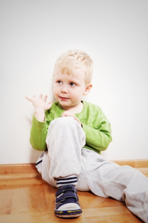 Little boy sitting on floor at home Stock Photo - 17643875
